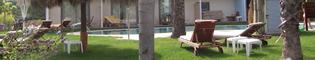 Club San Juan: Edificio y habitaciones con servicios exclusivos de 5 estrellas.